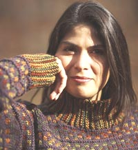 Close up of woman wearing a brown striped knitted raglan sweater