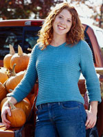 Woman wearing a blue knitted pullover sweater