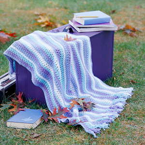 Blue and white striped knitted throw rug