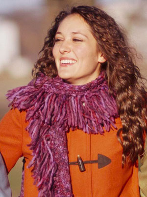 Close up of purple knitted scarf on woman