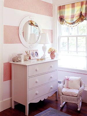 Dresser in pink wide-stripe bedroom