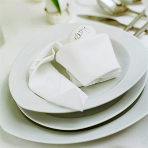 White place setting with napkin and white egg