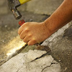 chiseling away cracked or loose mortar
