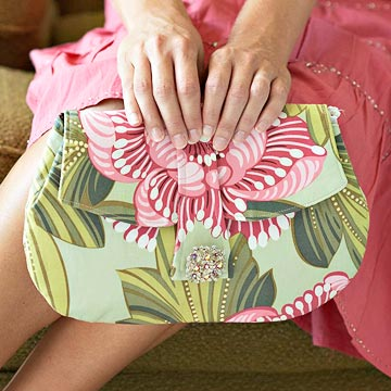 finished clutch purse, woman holding purse