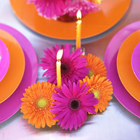 pink and orange flower and candle table arrangement