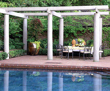 oversized arbor with dining table under