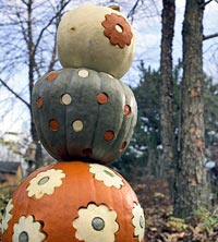 Orange, green, white pumpkin stack