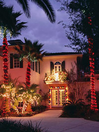 Exterior of house decorated in lights