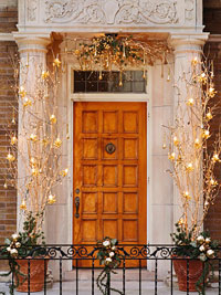 Front entrance decorated in lights