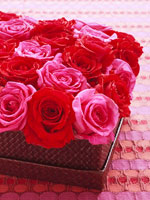 Red and pink rose centerpiece in box