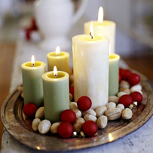 cream and green candles on gold tray