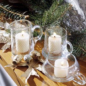 White candles in clear glass holders