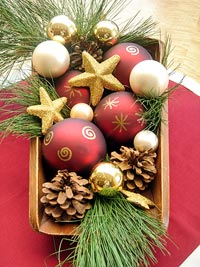 Holiday centerpiece box with bulbs and pine decor