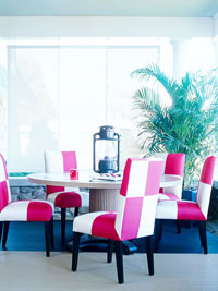 Dinning area with white and red checkered chairs