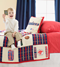 boy sitting on crocheted bedspread