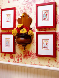 four frames against toile wall