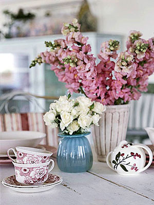 flowers and tea cup on table