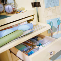 crafts station open drawer and gift wrap