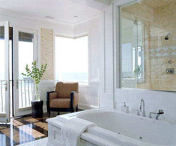 large white bath looking out to ocean