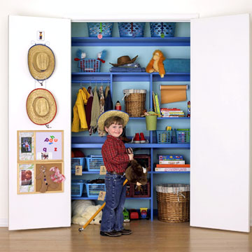 kid in front of blue closet
