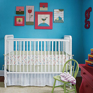 crib against blue wall