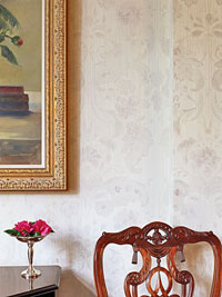 damask wall behind chair