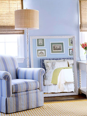 blue bedroom with mirror
