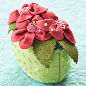 green and pink pin cushion