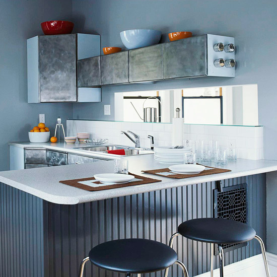 Sandblasted metal cabinets in gray kitchen