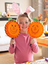 girl with pumpkin plate
