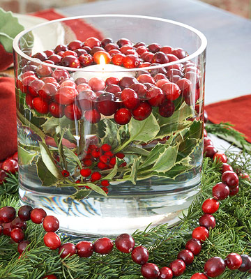 cranberries floating around white candle