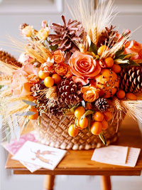 Basket w/ flowers and pinecones