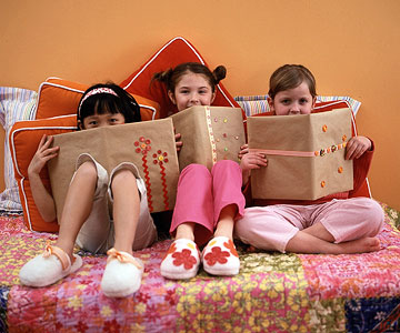 three girls with covered books