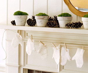 white gloves hanging from mantel