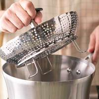 Putting steamer basket in pan