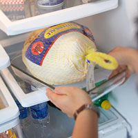 Putting a frozen turkey in refrigerator
