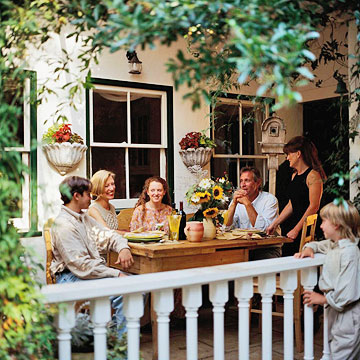 family eating outside on patio