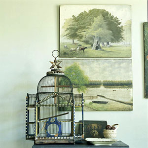 birdcage against two landscapes