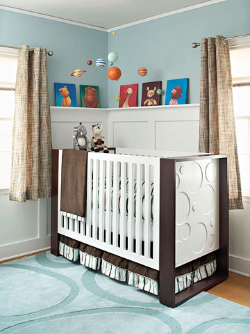 baby crib in blue and white room