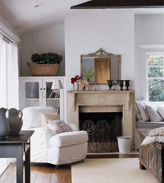 ivory fireplace with urns and mirror above
