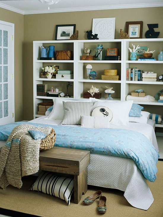 bed with shelves behind it