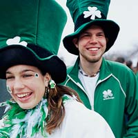 A male and female spectator wearing tall green top hats at the Chicago South Side Irish Parade in the Beverly, Illinois Neighborhood
