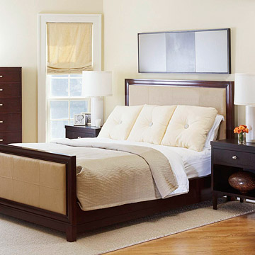 bed with three big ivory pillows