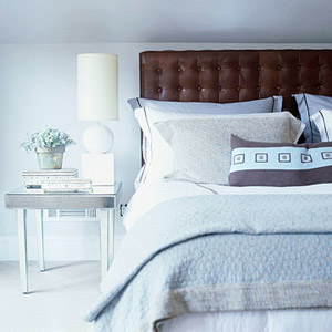 white room with brown headboard