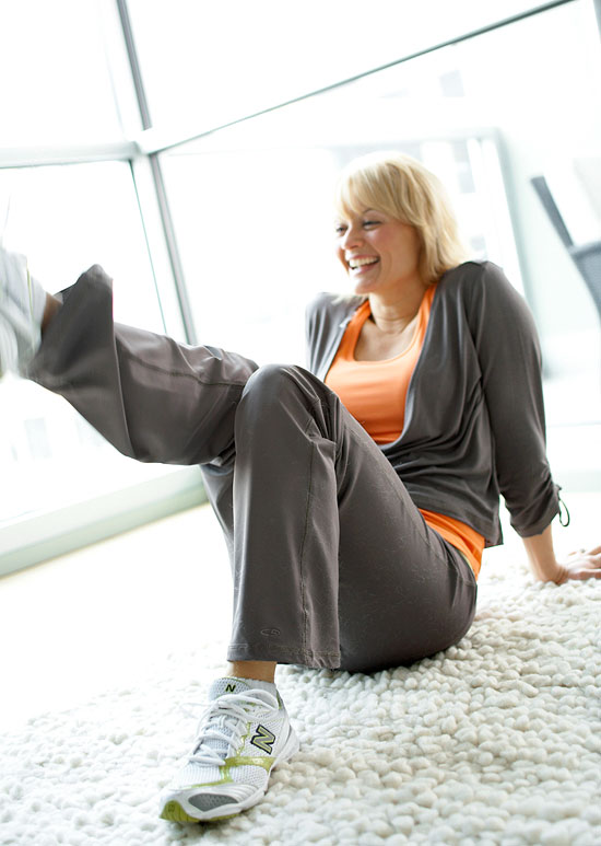woman in exercise gear on carpet