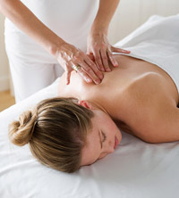 woman getting upper back massaged