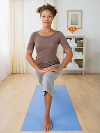 woman lunging forward in yoga pose