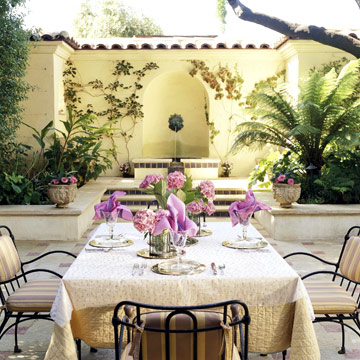 tuscan patio with purple flowers