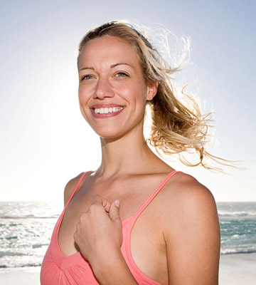 close up of smiling woman on beach