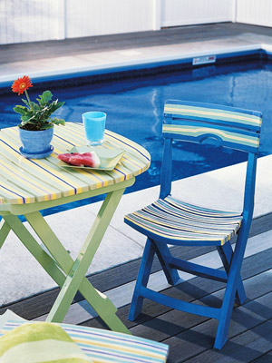 striped folding table by pool